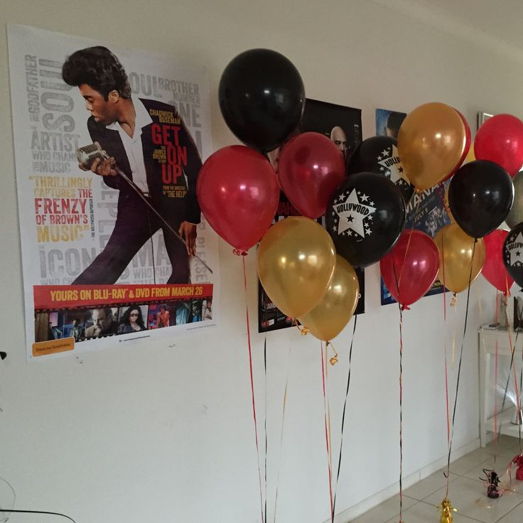 Hollywood themed birthday party ideas. Movie poster and balloons make for a great photo booth
