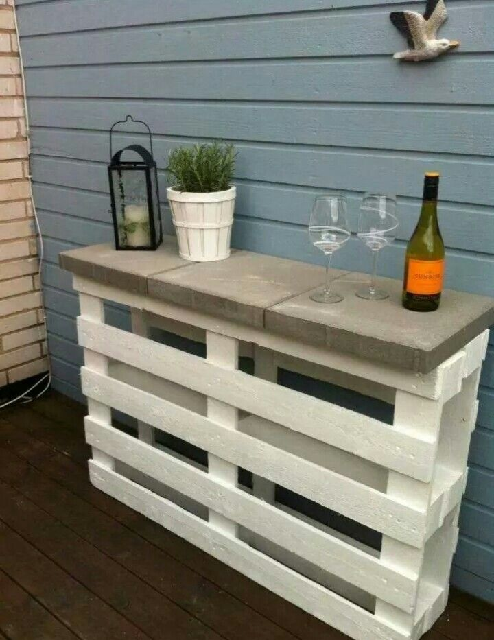 2 wooden pallet glued or screwed together, 3 cement pavers glued to top and use as a bar or buffet inside or outside.