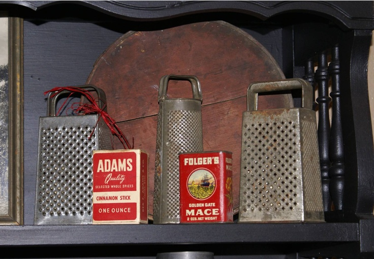 Cheese Graters - the red spice boxes are a very nice touch. I love prims but I like to mix them with all the other things I love...vintage, eclectic, retro...whatever catches my eye.