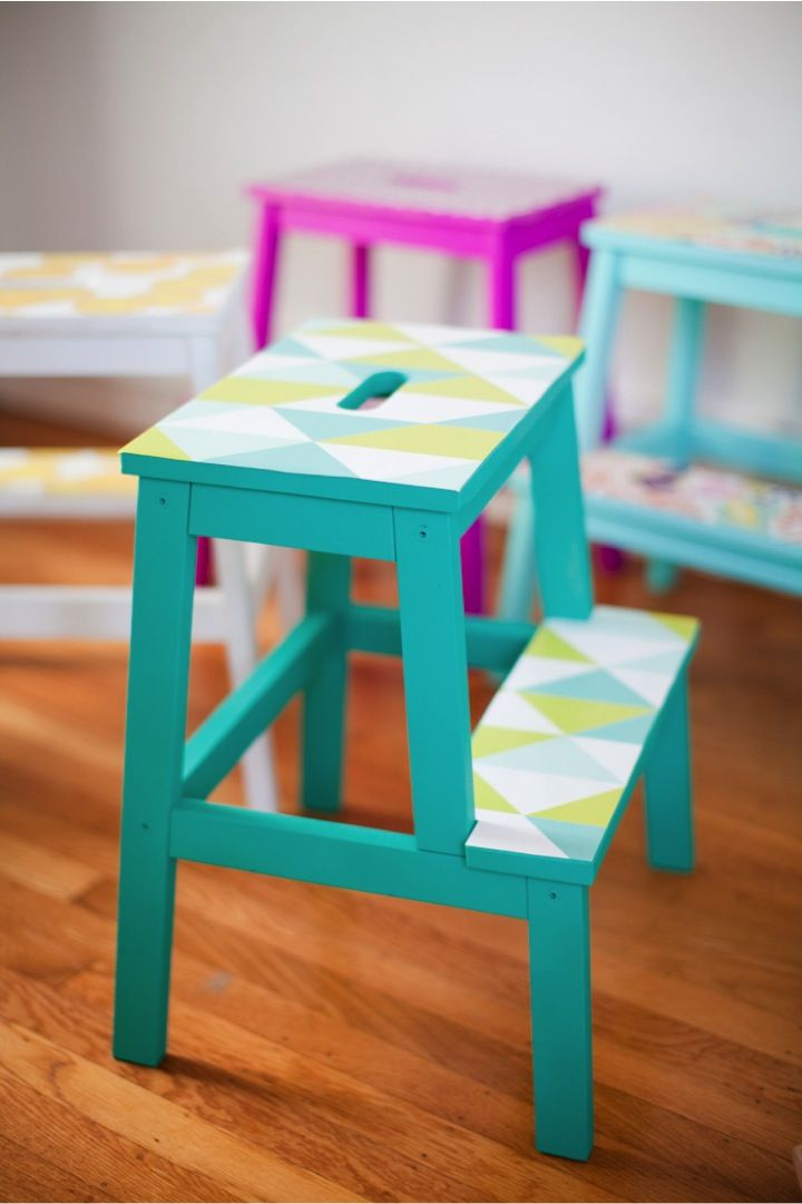 DIY wallpaper stools - I have one of these $15 stools from IKEA, and so far it's been left natural. But I'm loving the look of these brightly painted stools with wallpaper (or scrapbook paper would also work) on the top. Cute!