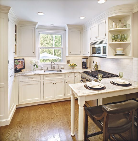 Heidi Piron's excellent small space kitchen. Love the peninsula and the custom cabinets.