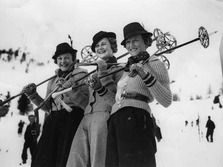 At St. Moritz, these smiling skiers don smart sweaters and traditional Tyrolean hats.