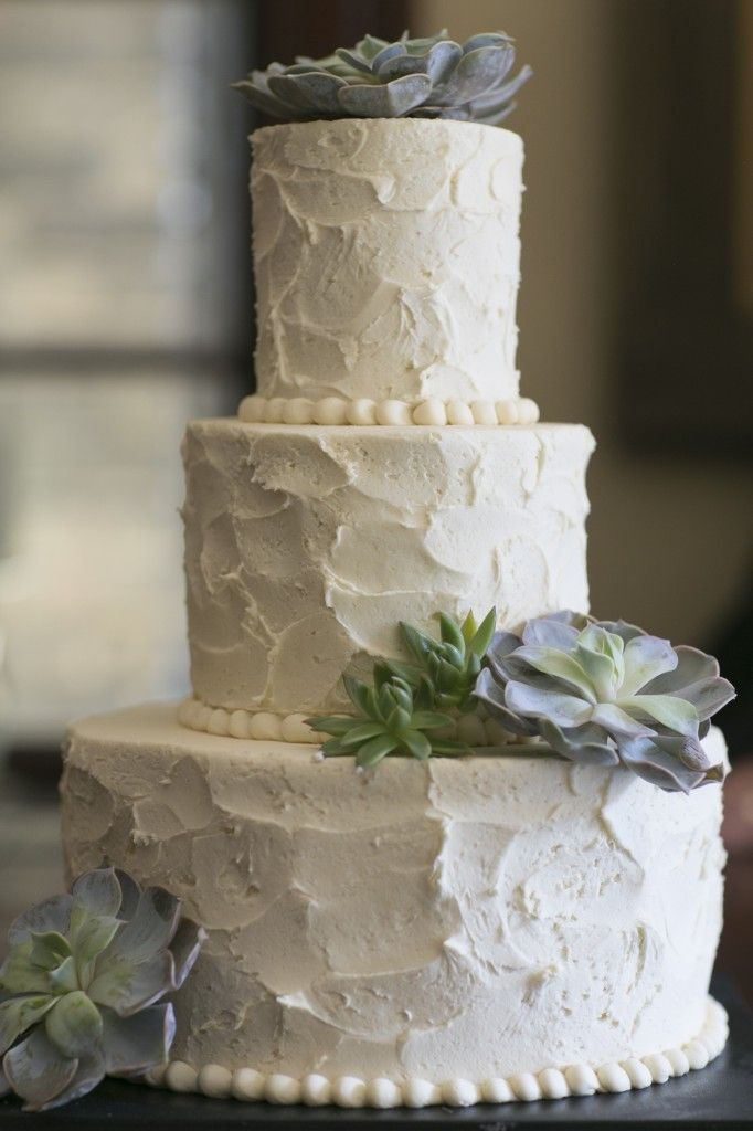 wedding cake with artificial succlent flowers | The wedding cake had accents of green and gray succulents.