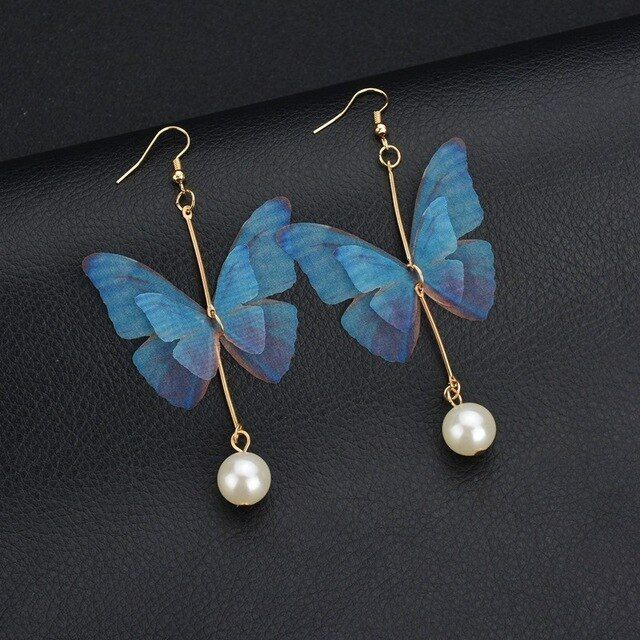Blue butterfly earrings with gold accent