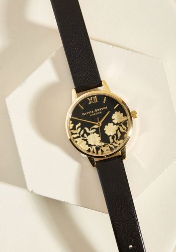 You have a deep fondness for beautiful timepieces, so we have a feeling things could get pretty serious with this black watch! With a lace-inspired, floral pattern on the dial of its gold-plated case, this leather time-keeper from Olivia Burton is a piece that effortlessly inspires endless adoration.