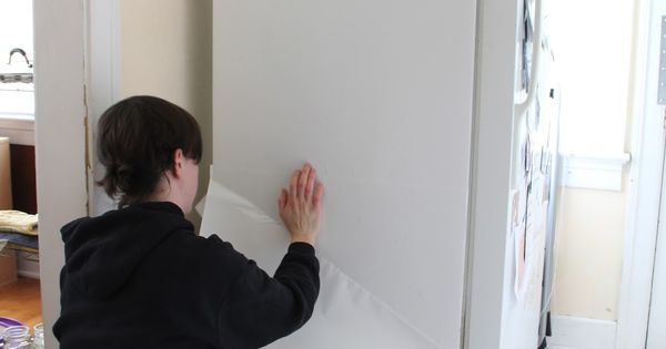 Liked on Pinterest: Ugly (and dirty old) fridges can be a problem in rentals. But you can disguise them without permanently altering them. We Can Make Anything has the instructions. First I lined the side of my refrigerator with white contact paper.