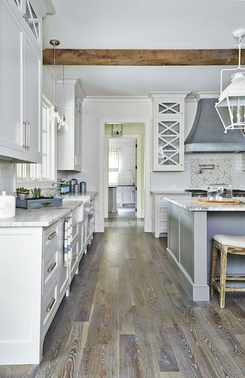 Great Rustic Kitchen Boasts A Zinc Hood Mounted Against Above A Wolf Range White  Glazed Subway Backsplash Tiles Framing Mosaic Cooktop Tiles Located Above A  ... Good Looking