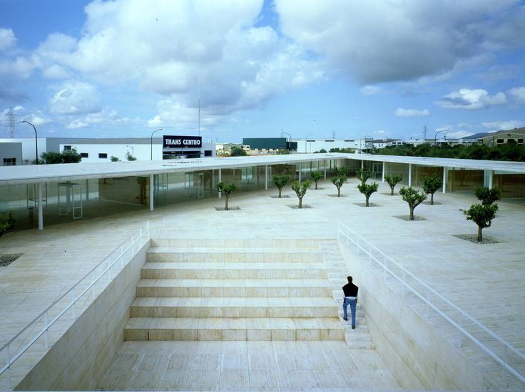 BIT Center in Inca, Mallorca, Spain 1998. High tech offices on a triangular shaped site. The site was excavated and a horizontal plane was set over it.