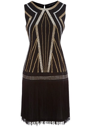 Embellished Flapper Dress Price: $130.00 DESCRIPTION A stand out piece from our collection, this black and gold embellished flapper dress has fringe detailing to the skirt and has a drop style waist. In a stretch material that simply slips over the head, this piece is sleeveless in style and has embellisment to the front.