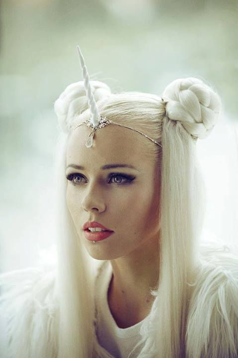 """kerli by vespertine"" with a unicorn horn as a costume"