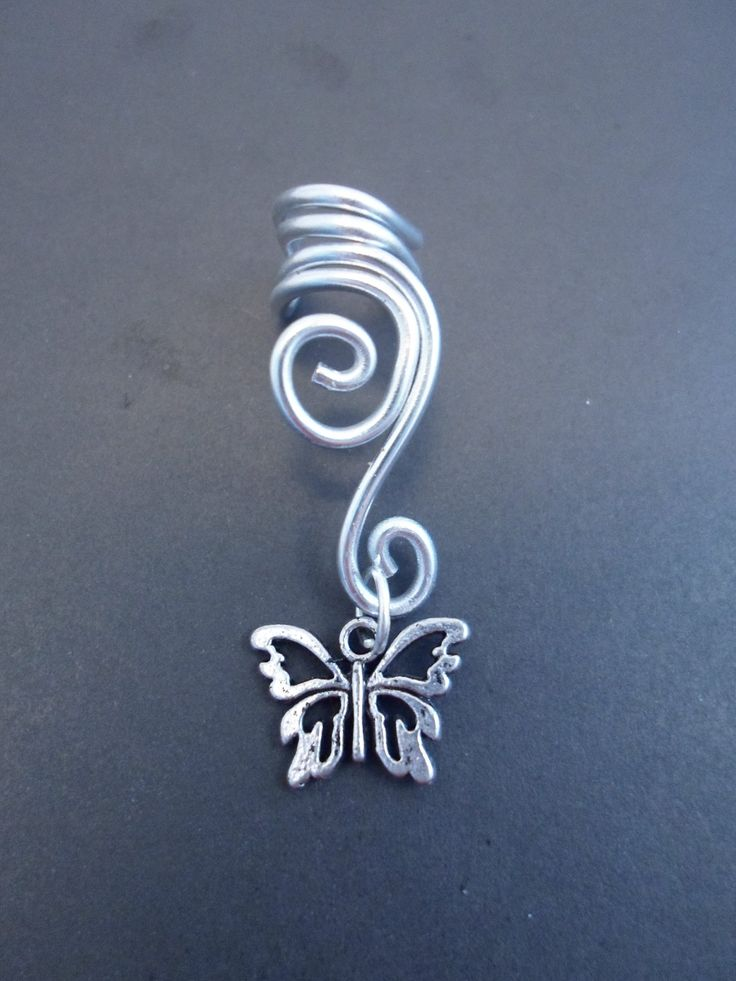 Double Spiral Ear cuff with butterfly in wire wrapped aluminium. (wire wrapping aluminum) Choose your color of aluminium... $10.00, via Etsy.