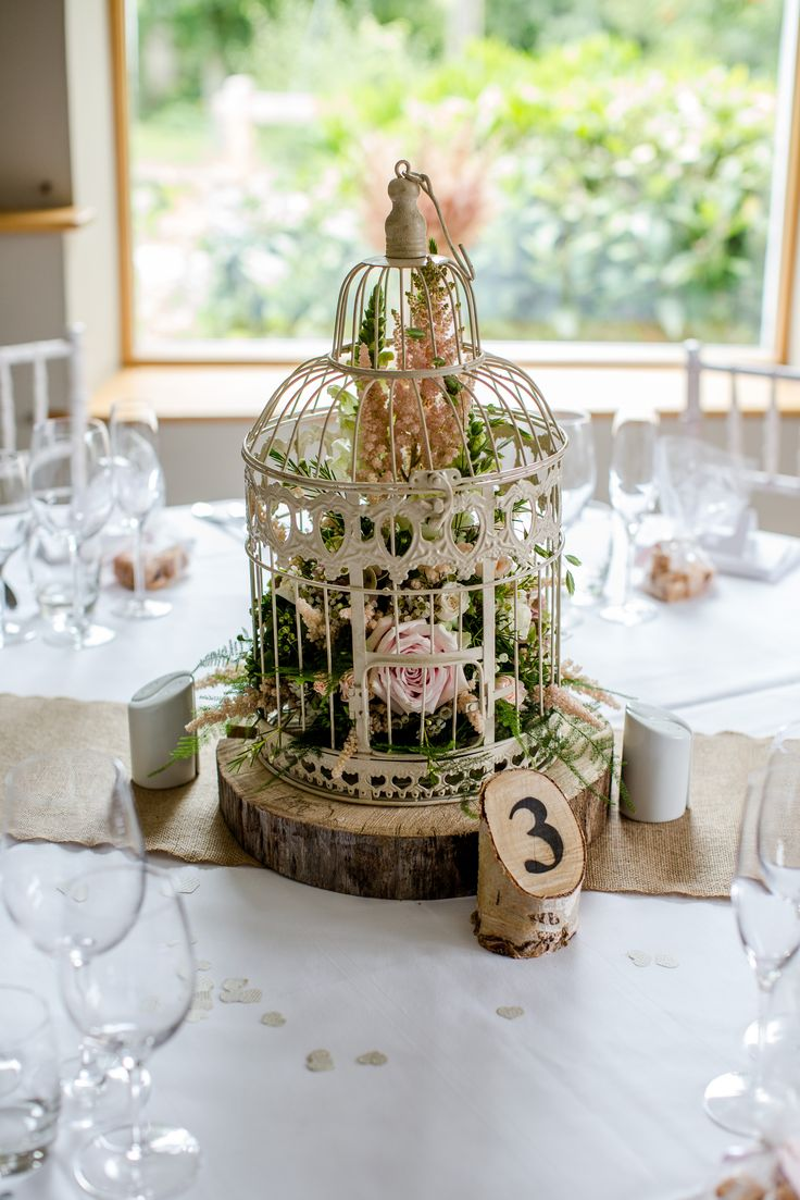 Vintage Bird Cage With Flowers Log Slice Wooden Table