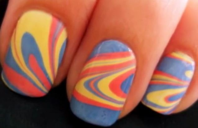 iLOVE doing this to my nails. want to learn how?? go to YouTube and look up marble nails or tie dye nails!! so cool!!
