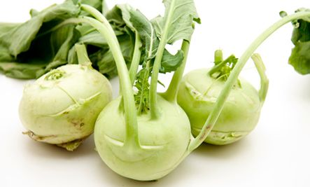 """Kohlrabi - German for """"cabbage turnip,"""" kohlrabi is related to the former vegetable. With high levels of vitamin C and and fiber, this unusual veggie is a nutritional powerhouse. It's tasty both raw and cooked, but needs to be peeled thoroughly — remove the top two layers."""