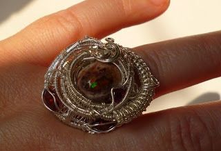 "Ring: ""Wish You Were Here"". Boulder Opal with Garnets wrapped in Sterling Silver"