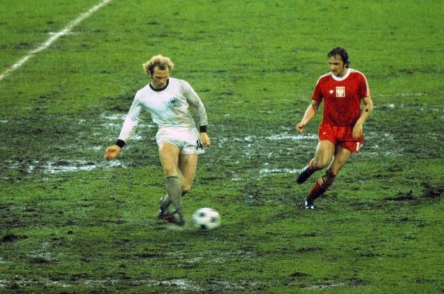 West Germany 1 Poland 0 in 1974 in Frankfurt. Uli Hoeness passes the ball on the heavy pitch in Round 2, Group B at the World Cup Finals.