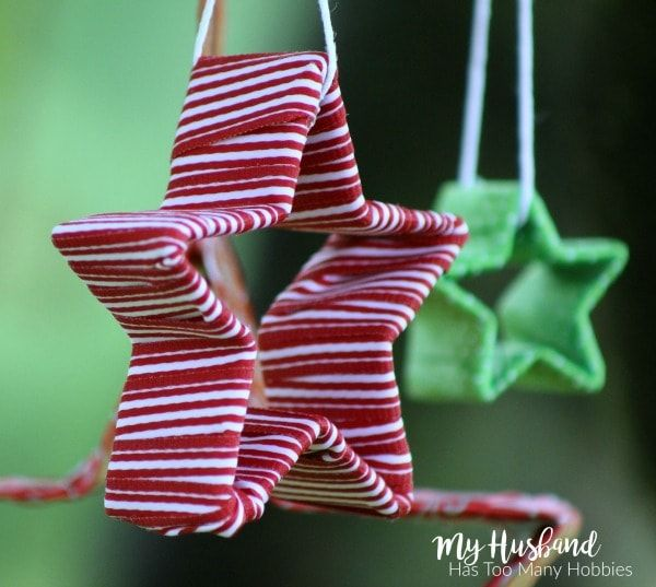 Easy-Christmas-Ornaments-Crafts.  Use ribbon scraps to wrap cookie cutters for an easy decoration or ornament.  Makes a great gift or present topper too!