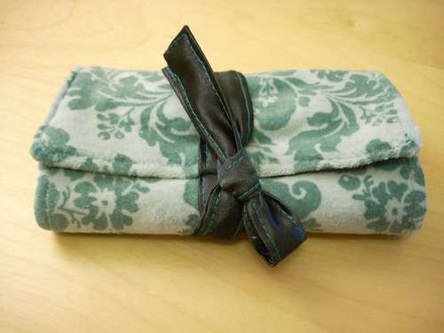 Travel Jewelry roll. I've seen others that use ribbons as hooks for necklaces instead of the top pocket. So cute!