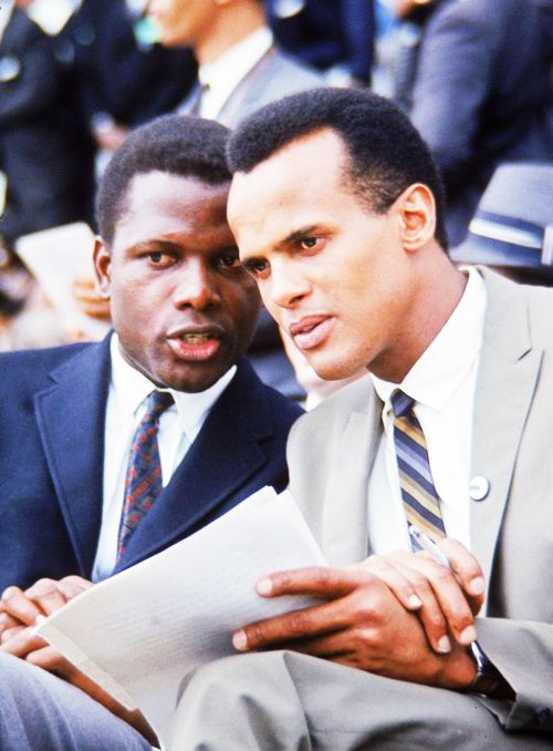 """Sidney Poitierand Harry Belafonte, who owned a Harlem restaurant together in the 1950s called """"Ribs in the Rough,""""at the March on Washington, 1963. Photographed by Francis Miller."""