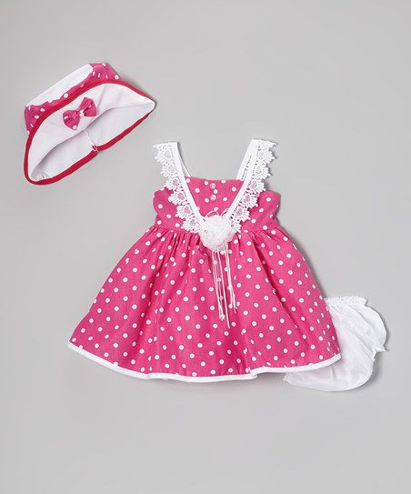 Showcasing lovely lace straps and a polka dot print, this enchanting frock has all the makings to transform little darlings into petite princesses. A buttoned back allows it to slip on easily, and a coordinating hat and diaper cover complete the look with a dash of whimsy.