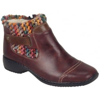 Rieker shoes are renowned for their comfort, style and the anti-stress technology which is unique to Rieker. This means that the shoes are lighter, flexible, shock absorbing and roomier. This trendy and practical boot with a funky multicoloured cuff is perfect to wear with jeans for that rugged casual look, making this boot suitable for all occasions.