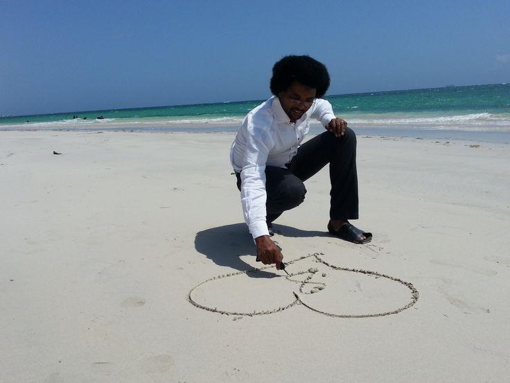 Abukar Albadri signing the wedding anniversary number on the ground at Liido beach in Mogadishu.