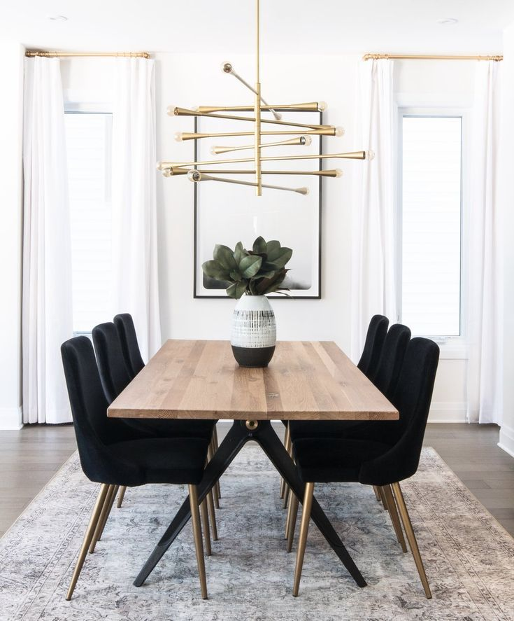 Natural Wood Table Black Dining Chairs And Modern Chandelier