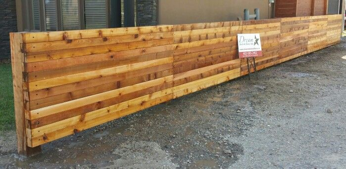 Cedar Fence/Wall with 6x6 cedar posts and 4x4 cedar posts stacked and lagged to 6x6's.......Very strong....