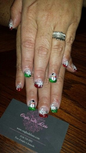 Christmas nails. Snowman, snowflakes, green, red, sparkles