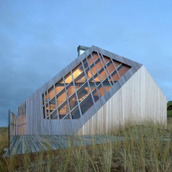 Dune House The Dune House Rises Over The Landscape On The Northern Coast Of The Island Of Terschelling Ne With Images Dunes House Modern Beach House Beach Cabin