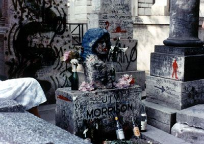 """Jim Morrison (1943 - 1971) - Damage done to original site by """"fans"""".  Litter, wine bottles, drug needles and graffiti were left behind. Souvenir hunters took every thing that could be uprooted or torn free. Officials have perceived the grave as a nuisance and suggest that when the lease expires a new burial site will have to be found."""