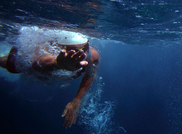 Lance Armstrong feels around underwater for his bike during the swim portion of the Xterra World Championship triathlon