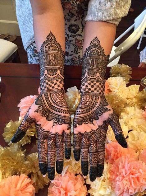 Intricate Temple Mehndi Design on Arms Designs
