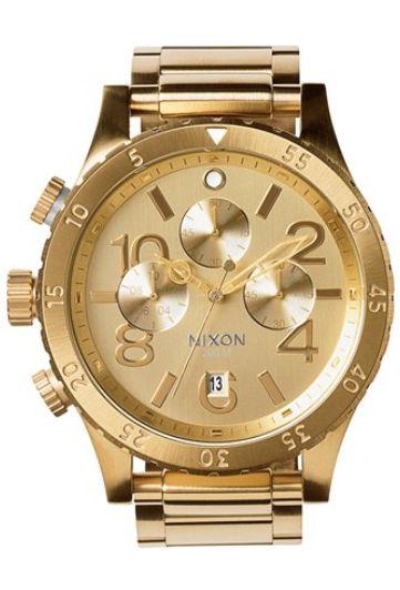 beautiful gold Nixon watch