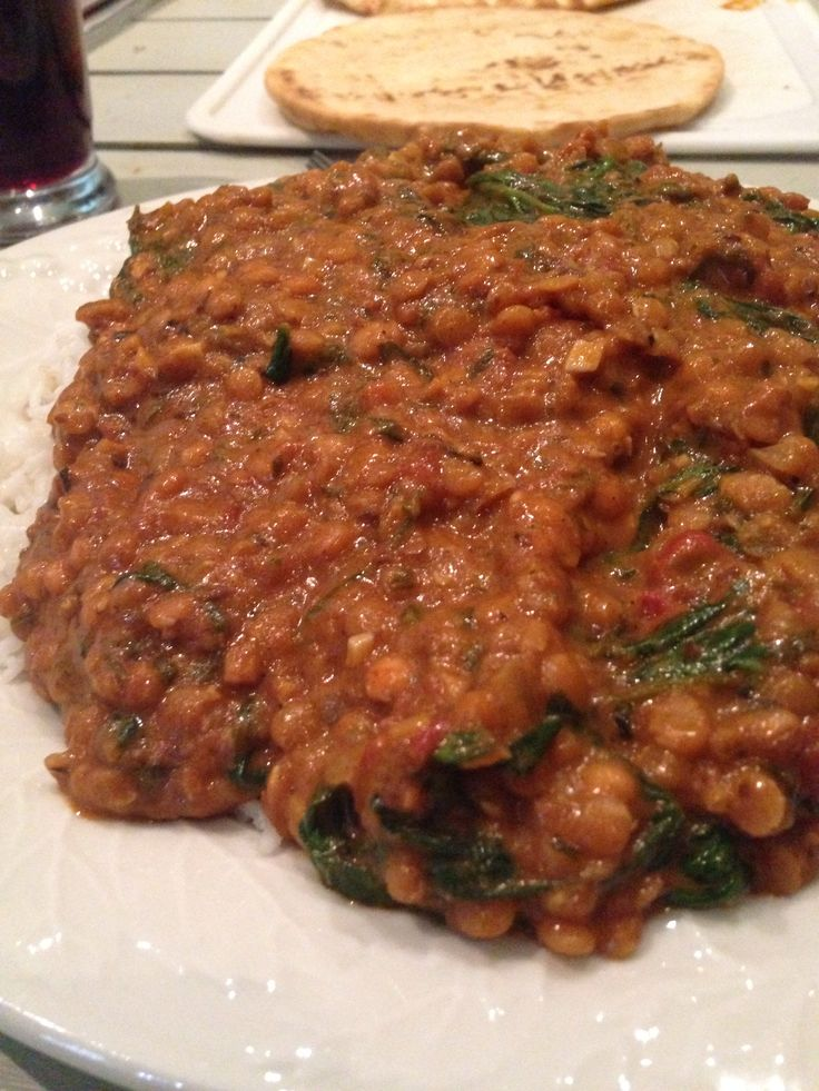 Red lentils and spinach in masala paste served with rice and naan Full recipe :  http://naturallyella.com/2012/11/23/red-lentils-and-spinach-in-masala-sauce/