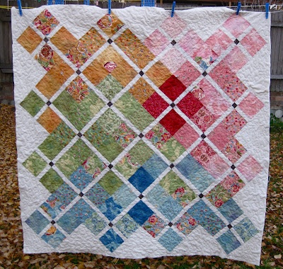 "Charm pack quilt tutorial - pattern calls for 3 charm packs + supplemental fabric to make a 56"" x 56"" quilt"