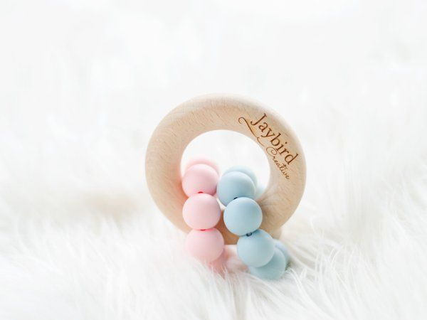 Jaybird Creative Double Ring Teether. Made with buttery soft silicone rings wrapped around a beech wood ring. Both hard and soft surfaces to soothe those aching teething gums