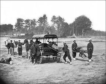 Civil War Medical Ambulance Corp Brady  Photo of a Civil War Ambulance Drill in the field with the newly organized Corps (1862) soon after Antietam.    PHOTOGRAPHER / CREDIT: Brady Civil War Photograph Collection  DATE: 1862