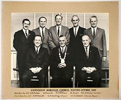 Henderson Borough Council Elected October 1965. Back Row (from left): A.K. Corban, S. Peacokc, A.L. Williams, A. Pryor, Mr. H. Kemp (Town Clerk). Front Row (from left): J. McDonald, R.A. Keeling (Mayor), G. Holborow (Deputy Mayor).  Auckland Council Archives: AUC 2015 064/3.