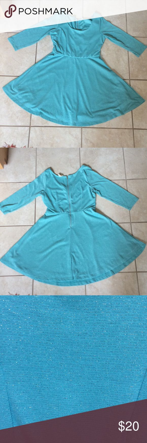 A Slightly Sparkly Blue Dress A cute, slightly sparkly, blue dress. There are silver stripes that are shown in the third picture. It falls around the knees, maybe a bit shorter depending on height. Red Camel Dresses Midi