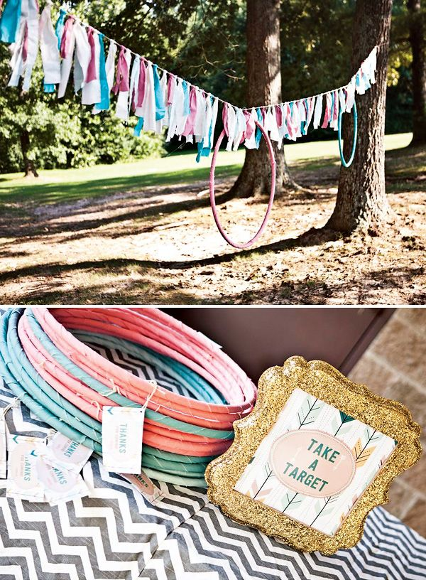 Girly and Stylish Bow & Arrow Themed Party. Love how they covered hula hoops in fabric :)