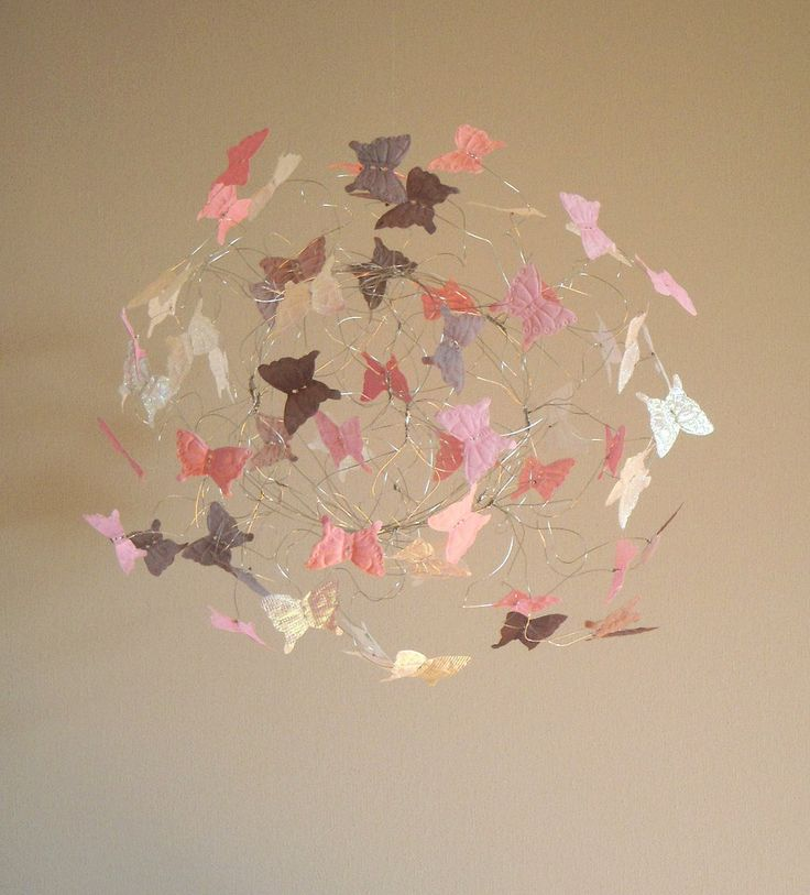 make this to go over AunaMarie's bed in red, blue and green. Baby Girl Nursery Mobile Pink, White and Grey Butterfly Mobile Nursery Decor Nursery. $48.00, via Etsy.