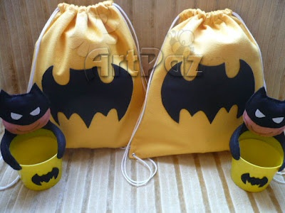we could find bags like this at micheals and do batman, the avengers A and the fantastic 4 logo in felt.