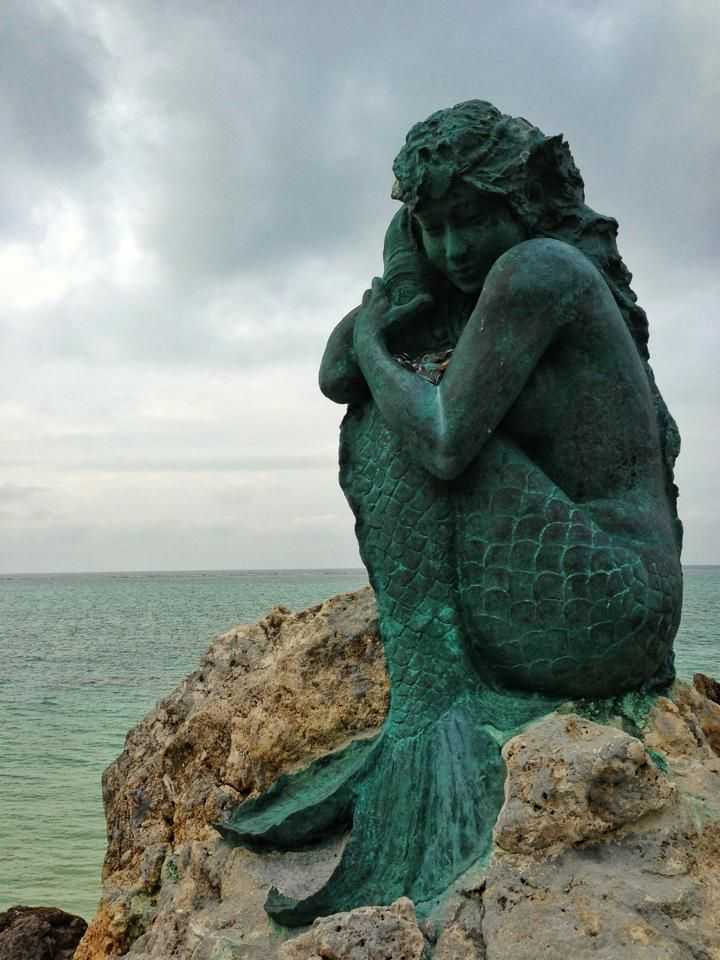 Mermaid sculpture by the sea, somewhere. Reminds me of a mermaid version of The Thinker.