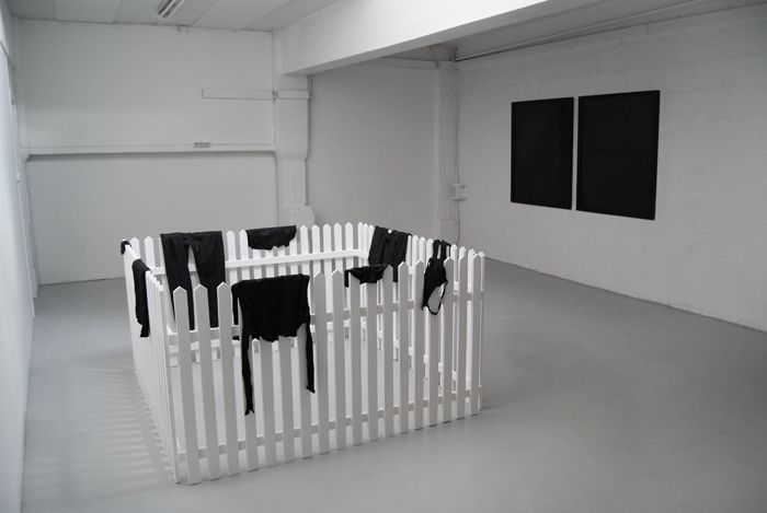Johan Øvergård Night and Day Bitumen petroleum, two sets of clothes, pine and paint, 180 x 180 x 110 cm, 2014
