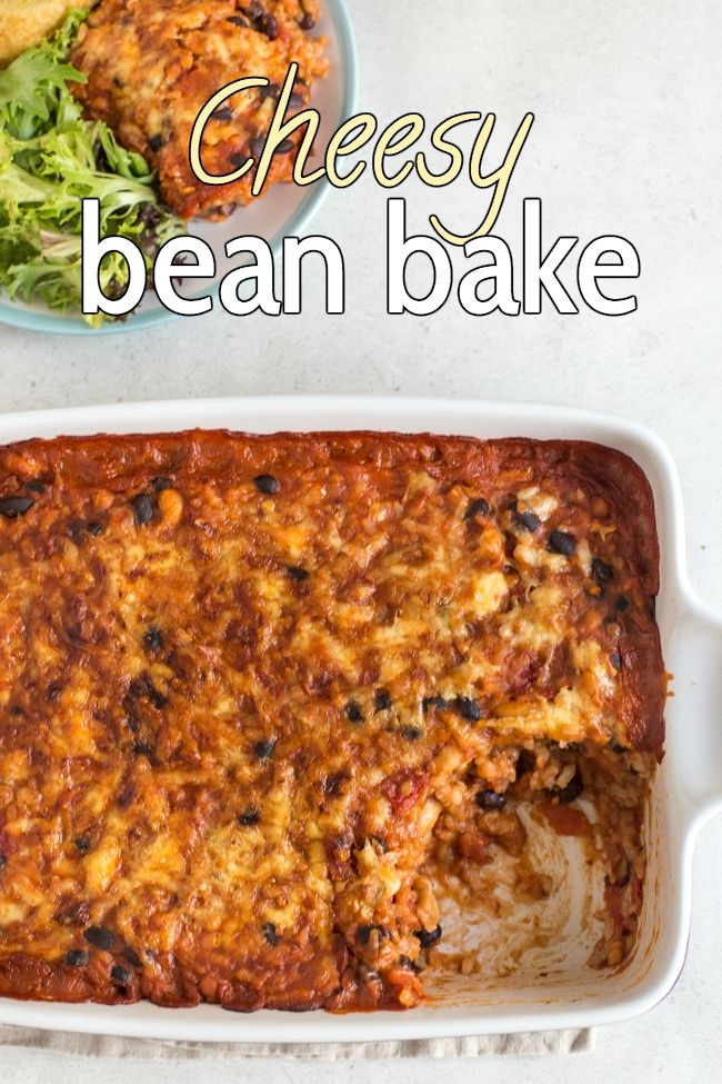 Cheesy bean bake - a rich and tomatoey bean and rice bake with lots of cheese! The perfect vegetarian crowd-pleaser - who doesn't love a cheesy casserole?! #vegetariancasserole #beanrecipes #vegetarianprotein #cheesycasserole #beancasserole #beanbake #arboriorice