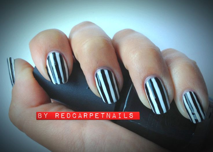On trend. Black and white vertical stripe nails. By RedCarpetNails £15.