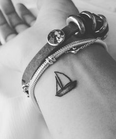 61 Impossibly Tiny And Tasteful Tattoos I just want this sailboat one