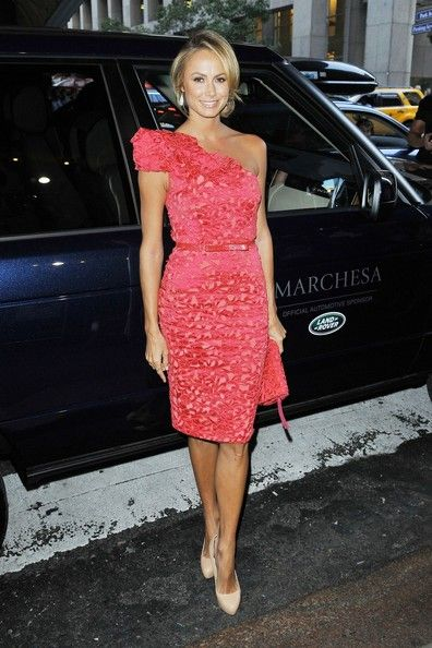 StyleBistro. Stacy Keibler pulls off another figure-accentuating look with this stunning hot pink one-shoulder dress at the Marchesa Spring 2013 show.