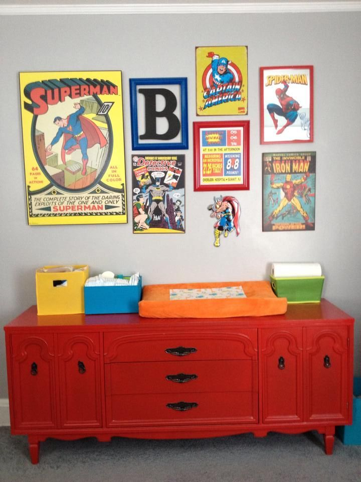 We painted this mid century modern dresser a deep brick red with black hardware. Perfect for a super hero themed nursery. This dresser is also being used as a changing table.